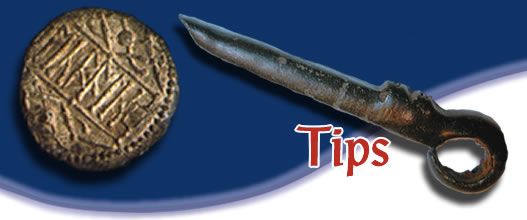 An artifact and coin artistically welcome you to the metal detecting hints tips page